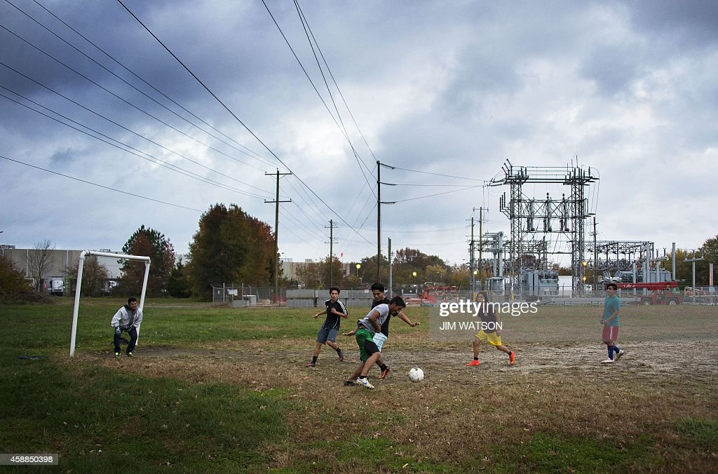 Local boys play soccer on a dirt field behind the Perdue chicken processing plant in what is locally known as 'Kimmeytown' an area of Georgetown...