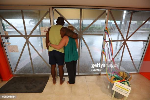 BOWEN QLD Local business owners Roger Matakamikamica and Tyler Matakamikamica take shelter before the worst of tropical cyclone Debbie hits in Bowen...