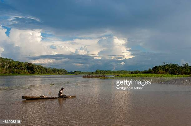 A local cabocolo man in a wooden canoe on a small river in the Peruvian Amazon River basin near Iquitos