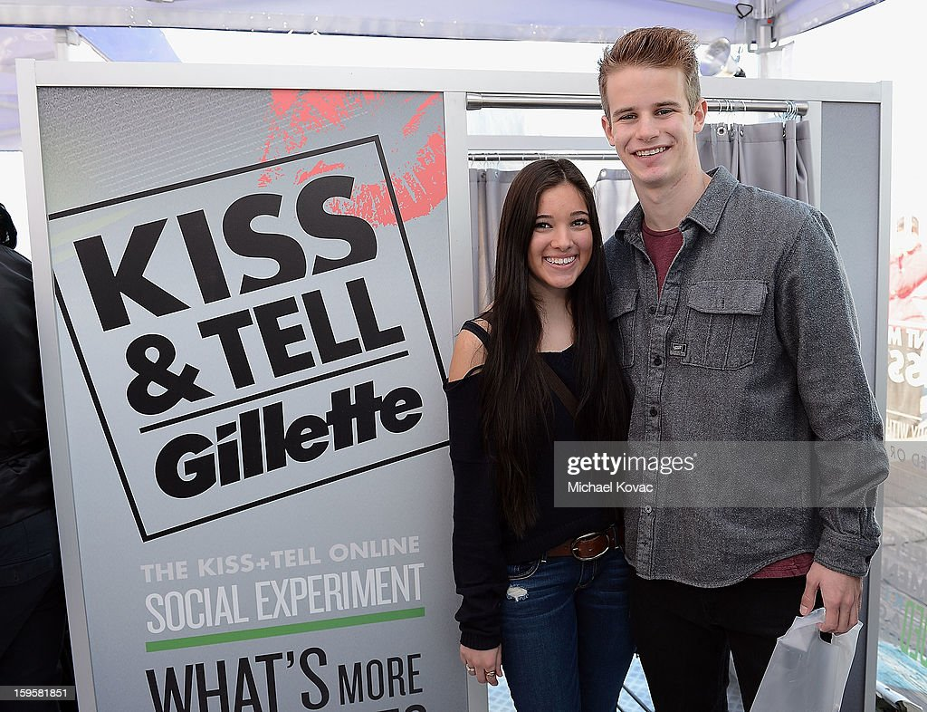 Local California couples take part in the national Gillette Kiss & Tell Live Experiment at Pacific Park at the Santa Monica Pier to determine which kiss is the best: a kiss with stubble or smooth shaven skin January 16, 2013 in Santa Monica, California.