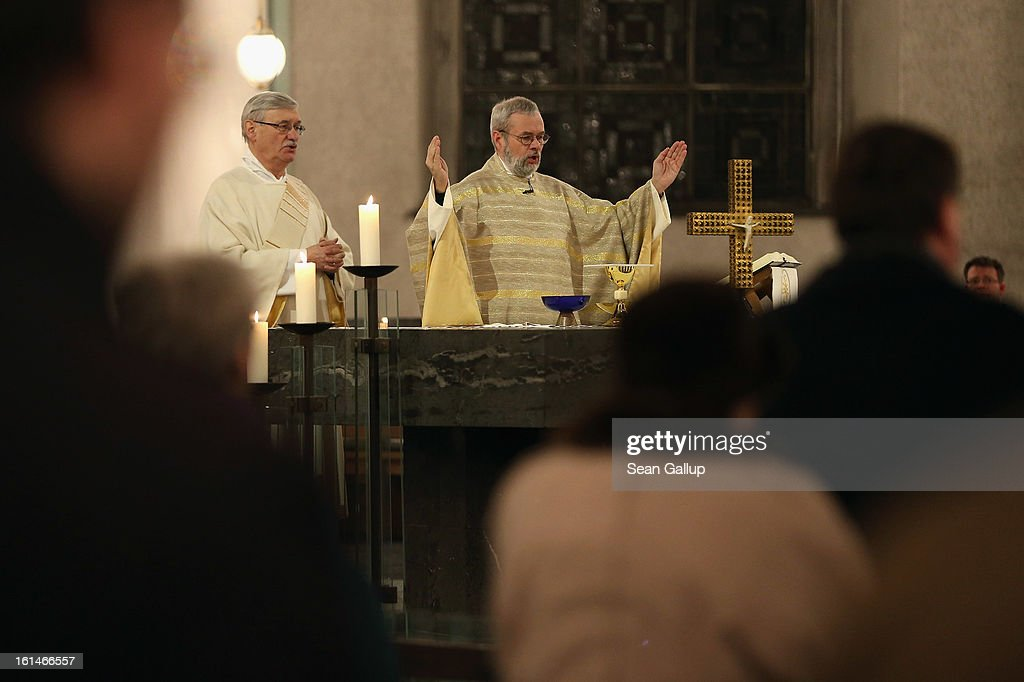 Local Catholic clergy lead worshippers in a special evening mass at St. Hedwig Catholic cathedral following the announced resignation of Pope Benedict XVI on February 11, 2013 in Berlin, Germany. Pope Benedict XVI, born Josef Ratzinger in Germany, announced to Vatican clergy on Monday that he feels too physically frail to continue meeting the demands of being the Pope and will step down officially on February 28.