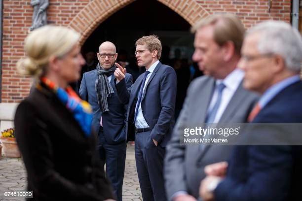 Local CDU lead candidate Daniel Guenther and CDU General Secretary Peter Tauber are pictured as they wait for German Chancellor and Chairwoman of the...