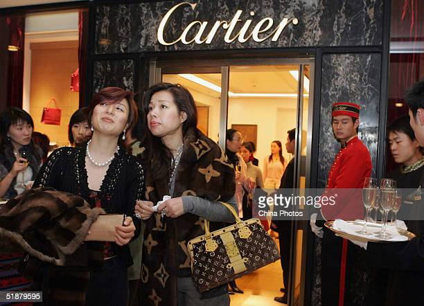 Local celebrities attend the opening ceremony of Cartier's new flagship store on December 18 2004 in Shanghai China Luxury brands like Armani Louis...