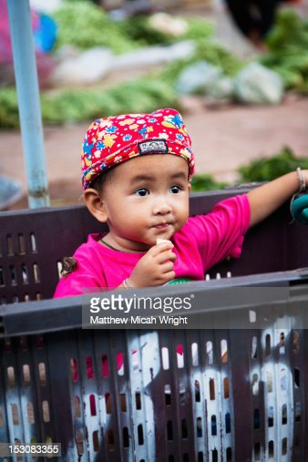 A local child in a basket. : Stock Photo