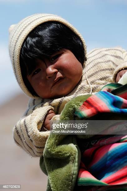 A local child is pictured during Day 9 of the 2014 Dakar Rally near the Salar de Uyuni or Uyuni Salt Flats on January 13 2014 in Uyuni Bolivia