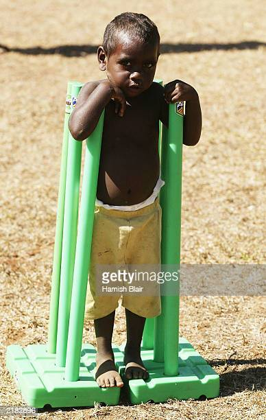 A local child plays in a set of stumps on July 22 2003 during a team visit to an Aboriginal settlement on Melville Island off the coast of Darwin...