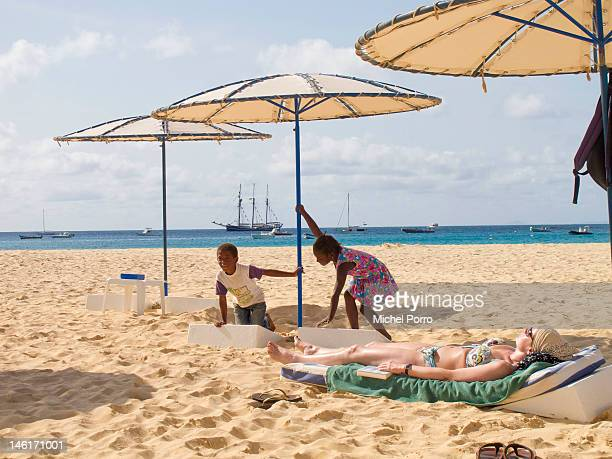 Local childeren play at Santa Maria beach on May 15 2012 in Sal Rei Cape Verde Favorable exchange rates in the Cape Verde Islands have recently...