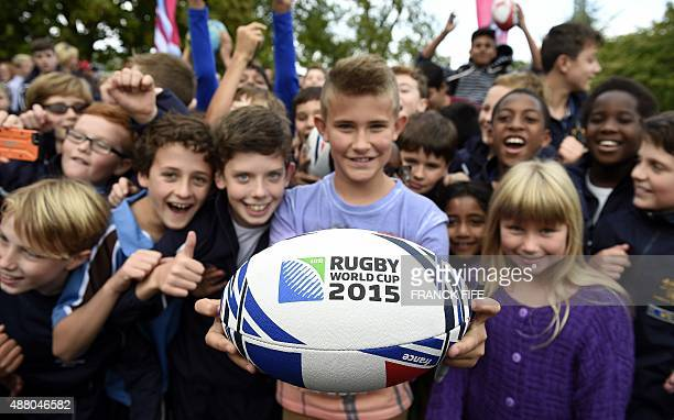 Local children await the arrival of the French rugby team before their training session at the Trinity School in Croydon south of London on September...