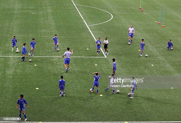 Local children participate in a football training session at the ASPIRE Academy for Sports Excellence on January 25 2011 in Doha Qatar