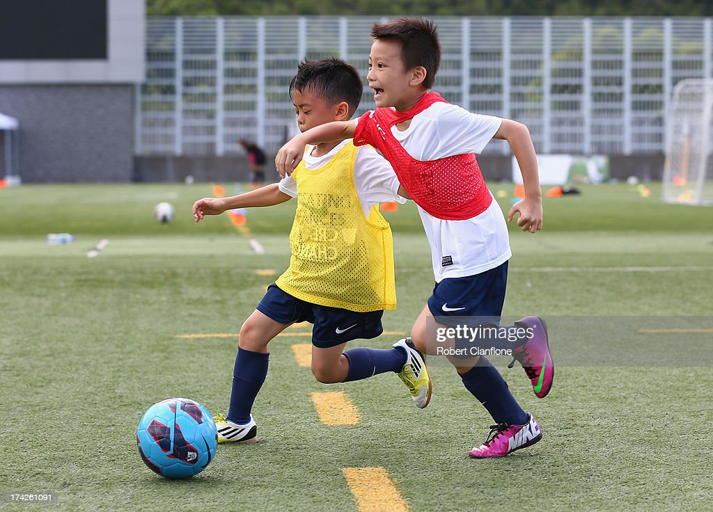 Local children participate in the Premier Skills and Creating Chances open day on July 23, 2013 in Hong Kong, Hong Kong.