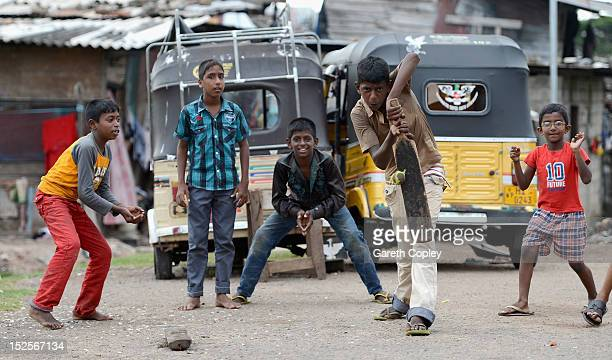 Local children play cricket on the streets outside the R Premadasa Stadium during the ICC World Twenty20 2012 Group B match between Australia and the...