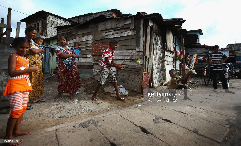 Local children play cricket on the streets outside the R. Premadasa Stadium ahead of the ICC World Twenty20 2012 Group A match between England and India on September 23, 2012 in Colombo, Sri Lanka.
