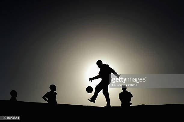 Local children play football in the Khayelitsha Township on June 9 2010 in Cape Town South Africa