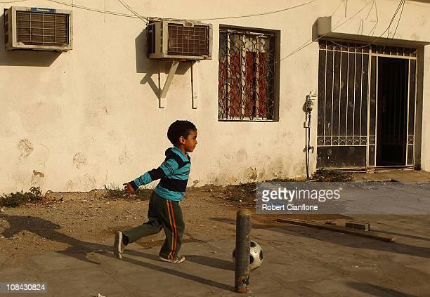 Local children play football on a street on January 27 2011 in Doha Qatar