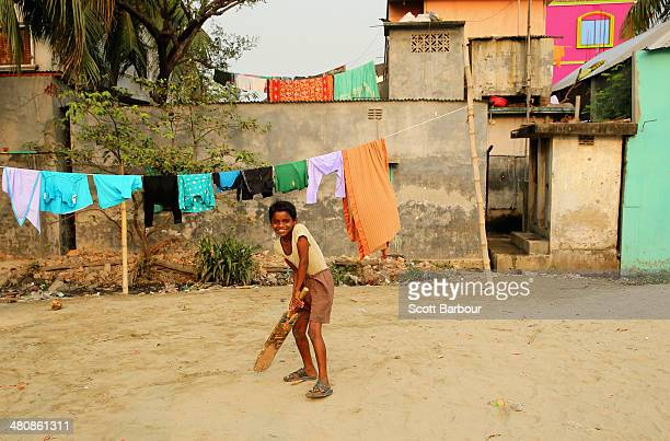 Local children play street cricket in the suburbs of Dhaka during the ICC World Twenty20 Bangladesh 2014 on March 27 2014 in Dhaka Bangladesh
