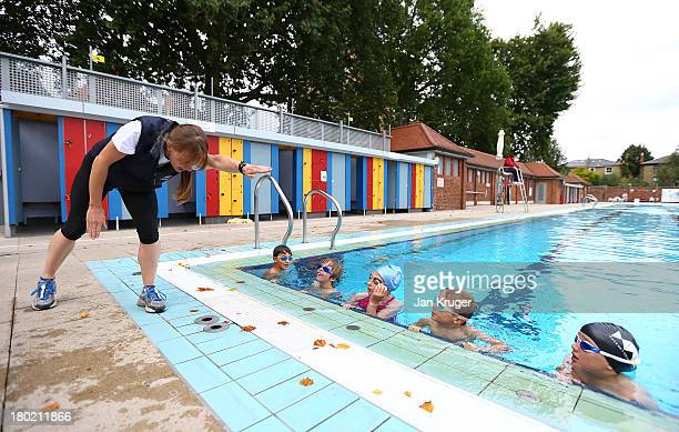 Local children receive a swimming lesson during the launch of 'TRI3SPORTZ' Legacy Initiative on the Eve of the London Triathlon Grand Final on...