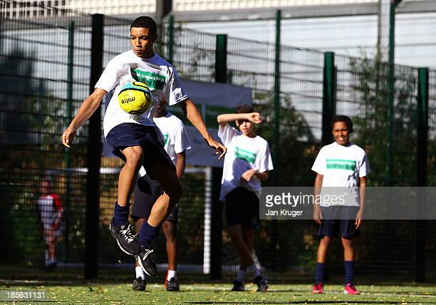 Local children take part in a training session during the Premier League and the FA Facilities Fund Launch at The London Nautical School on October...