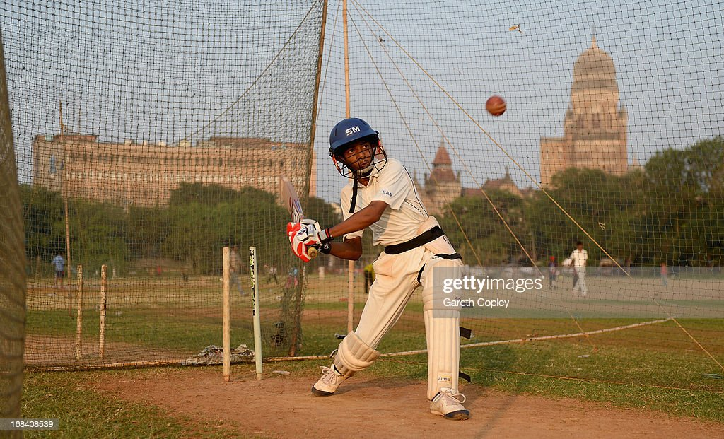 Local children take part in cricket practice at Azad Maidan on November 22, 2012 in Mumbai, India.