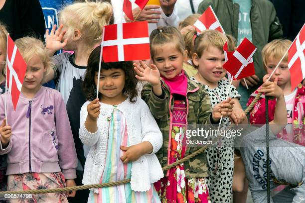 Local children with the flag Dannebrog are ready tp welcome their Queen during her arrival with the Royal ship on June 15 2017 in Hobro Denmark The...