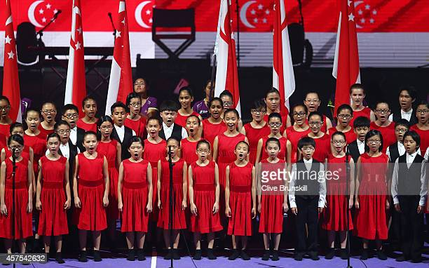 A local choir sing at the opening ceremony prior to the start of the opening round robin match of the BNP Paribas WTA Finals at Singapore Sports Hub...