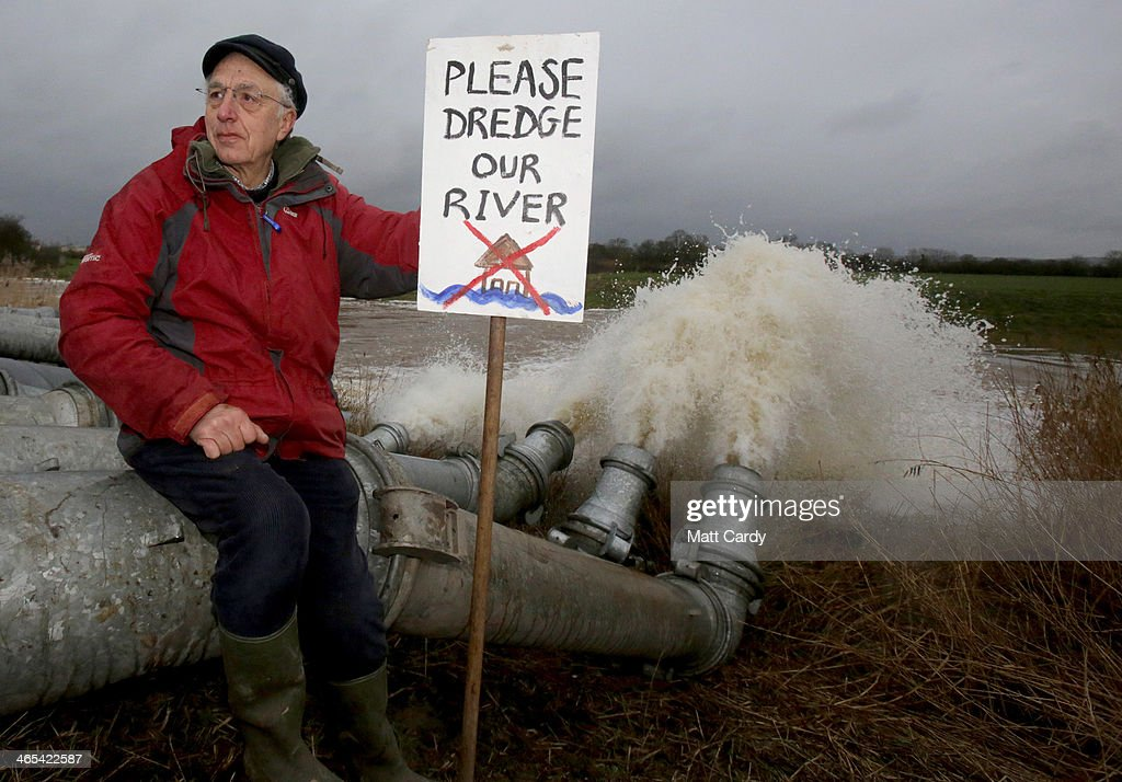Local councillor Julian Taylor poses for a photograph besides the pump outlet following a visit by the Environment Secretary Owen Paterson at the...