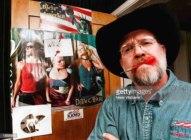 Local country radio personalities K C Daniels has been tossing darts at a poster of the singing trio the Dixie Chicks taped to the studio door at...