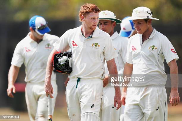 Local cricketer Tom Andrews talks with Adam Zampa during day three of the Australian Test cricket intersquad match at Marrara Cricket Ground on...