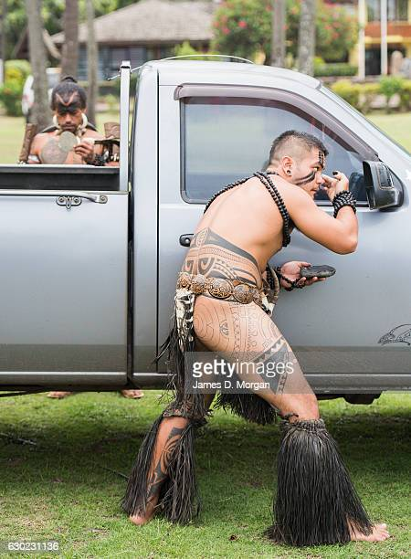 Local dancers preparing their makeup using their car wing mirrors for the guests of the Aranui 5 on December 01 2016 in Marquesa Islands French...