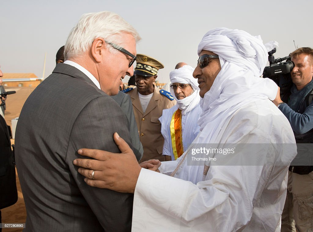 A local dignitary (R) welcomes German Foreign Minister <a gi-track='captionPersonalityLinkClicked' href=/galleries/search?phrase=Frank-Walter+Steinmeier&family=editorial&specificpeople=603500 ng-click='$event.stopPropagation()'>Frank-Walter Steinmeier</a> (L) during his visit to german and french soldiers in Camp Castor on May 02, 2016 in Gao, Mali. Steinmeier and French Foreign Minister Marc Ayrault (not pictured) visit Mali and Niger for political conversations.