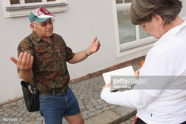 Local Eberhard Aszmus speaks to a reporter from Hamburger Abendblatt August 22 2007 in Muegeln Germany A group of approximately 50 youths some of...