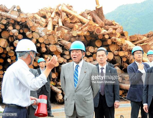 Local Economy Vitalizing Minister Shigeru Ishiba listens to explanation during his inspection of the Biomass Maniwa on June 13 2015 in Maniwa Okayama...