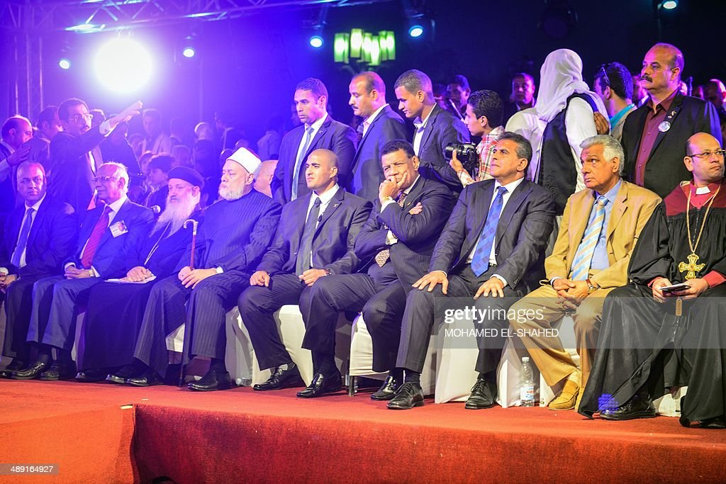 Local Egyptian personalities attend a rally in support of Egypt's former army chief Abdel Fattah al-Sisi in the capital Cairo on May 10, 2014. The retired field marshal, who toppled elected Islamist president Mohamed Morsi in July, is expected to sweep the May 26-27 election.