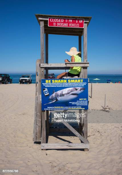 A local employee keeps track of vehicular traffic and parking quotas on the beach in East Orleans Massachusetts July 16 2017 The town of East Orleans...
