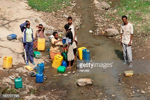 Local ethiopians taking water to plastic canisters