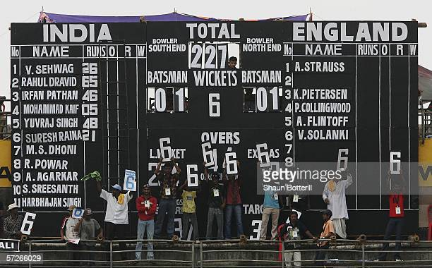 Local fans make use of the spare sixes on the scoreboard during the fourth one day international between India and England at the Jawaharlal Nehru...