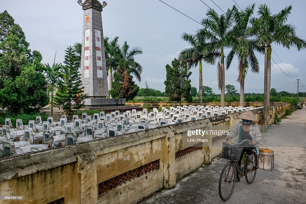A local farmer passes by Co Loa Martyrs Cemetery on May 25, 2016 in Hanoi, Vietnam. U.S. President Obama made his historic visit to Vietnam on May 23 with an aim to strengthen the strategic and economic relationship between both countries four decades after the Vietnam war. During the visit, Obama announced the U.S. will fully lift its embargo on weapons and raised issues related to human rights while speaking to the youths on freedom of expression.