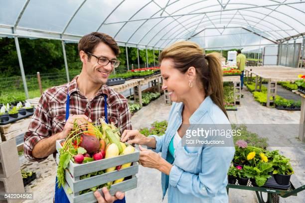 Local farmer talks with customer at farmers' market