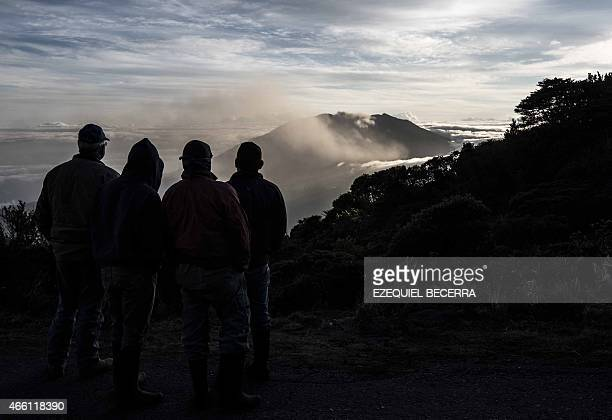 Local farmers look at the Turrialba volcano near San Jose taken on March 13 2015 The volcano showered nearby towns with ash forcing evacuations from...