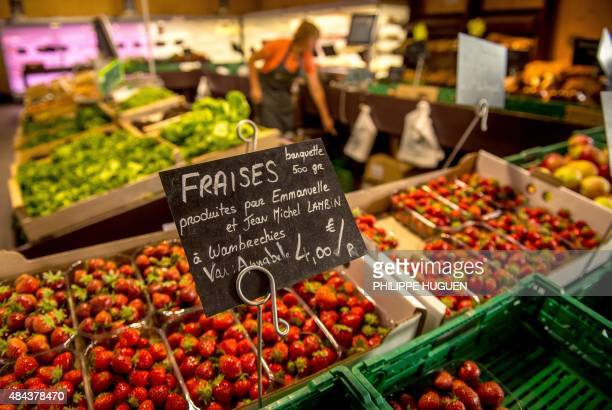Local farmers' names are written on a sign selling strawberries in a 'Talent de ferme' grocery store which provide only products from local farmers...