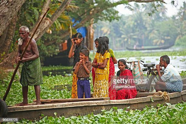 Local ferryman is ferrying passengers across the famous backwaters of Alleppey on December 25 2009 in Alapuzha near Trivandrum Kerala India