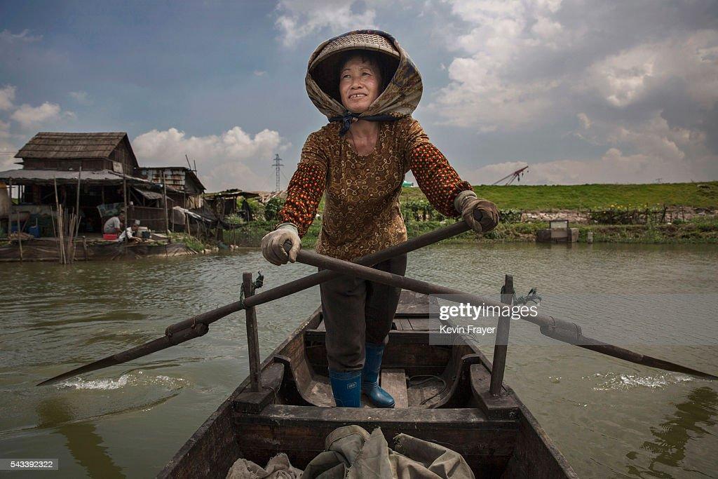 Local fisherman Chen Shourongon paddles her boat on Shazai Island where the Sun YatSen UniversityMichigan University Joint Center of Vector Control...