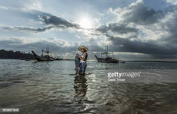 Local fisherman with net