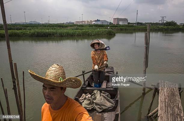 Local fishermen Gao Wen and wife Chen Shourongon stand in their boat on Shazai Island where the Sun YatSen UniversityMichigan University Joint Center...