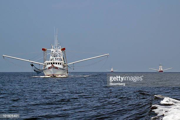 Local fishing boats are used to skim oil from BP Plc's leaking Macondo well off the coast of Biloxi Mississippi US on Monday June 7 2010 The biggest...