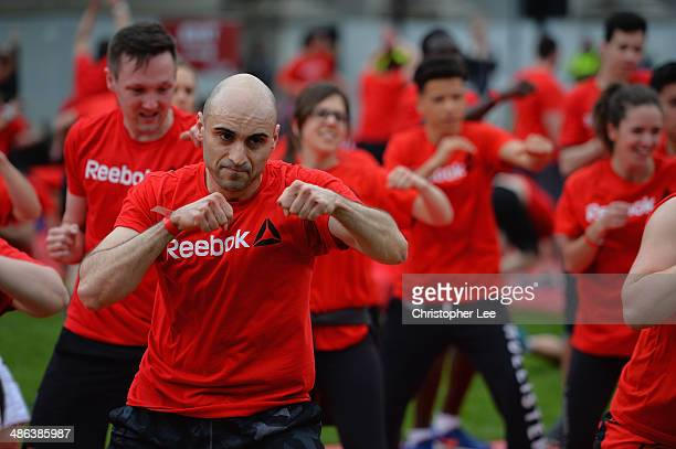 Local fitness enthusiasts gather at Marble Arch to take part in simultaneous CrossFit Les Mills and Spartan workouts to celebrate Reebok's new brand...