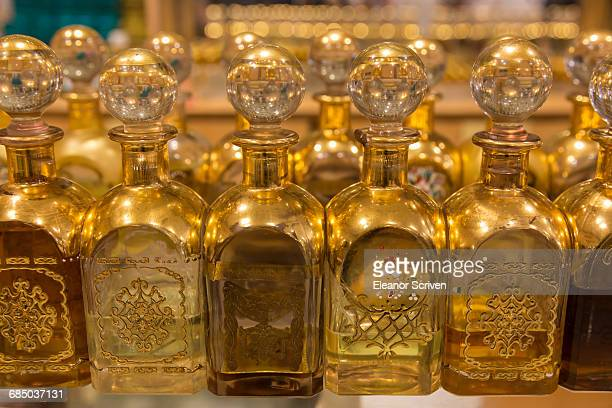 Local frankincense perfumes in ornate gold and glass bottles, Al-Husn Souq, Salalah, Dhofar Region, Southern Oman, Middle East