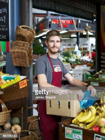 Local Fruit Shop Owner at Market