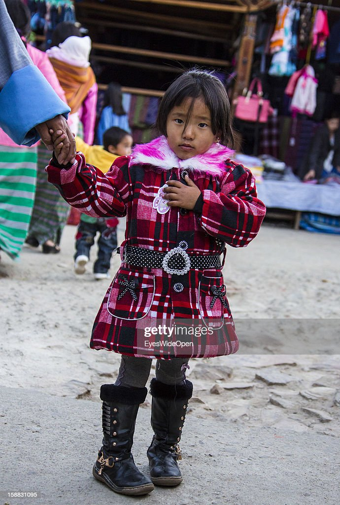 Local girl in nice warm clothes on November 18, 2012 in Thimphu, Bhutan.