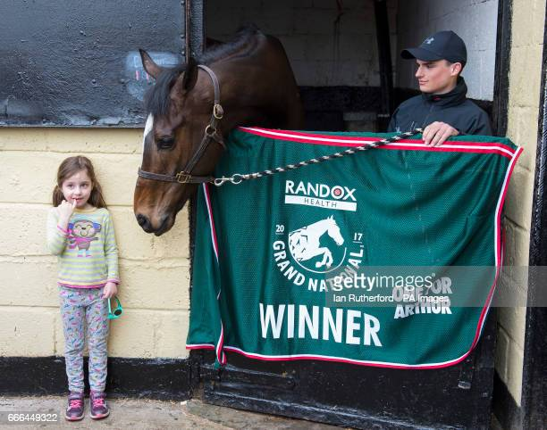 Local girl Lucy Watson from Milnathort gets her picture taken with Grand National winner One For Arthur with stable lad Alexander Thorn looking on at...
