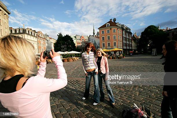 Local girls posing for photos on Dome Square.